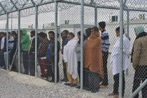 Detainees behind the fence at Amygdaleza detention center, Greece; February 2015 Source: WikiMedia; Unknown Photographer
